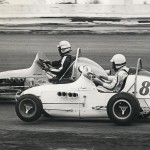 Bill Vukovich II  in car 8 and Nigel (Paul) Bates in car 82.  Midget car race in 1968 in Claifornia.